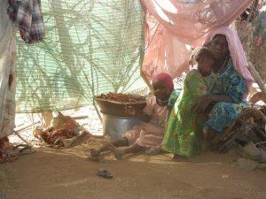 IDP family in Sortoni camp, outside UNAMID base (Nuba Reports)