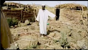 Father Yacoub Omar (L)  & Mayor Ayman Omar (R) at bomb site (Nuba Reports)