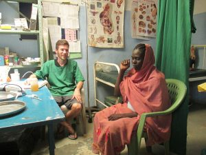 Johannes Plate with a patient at Lewere Hospital (Nuba Reports)